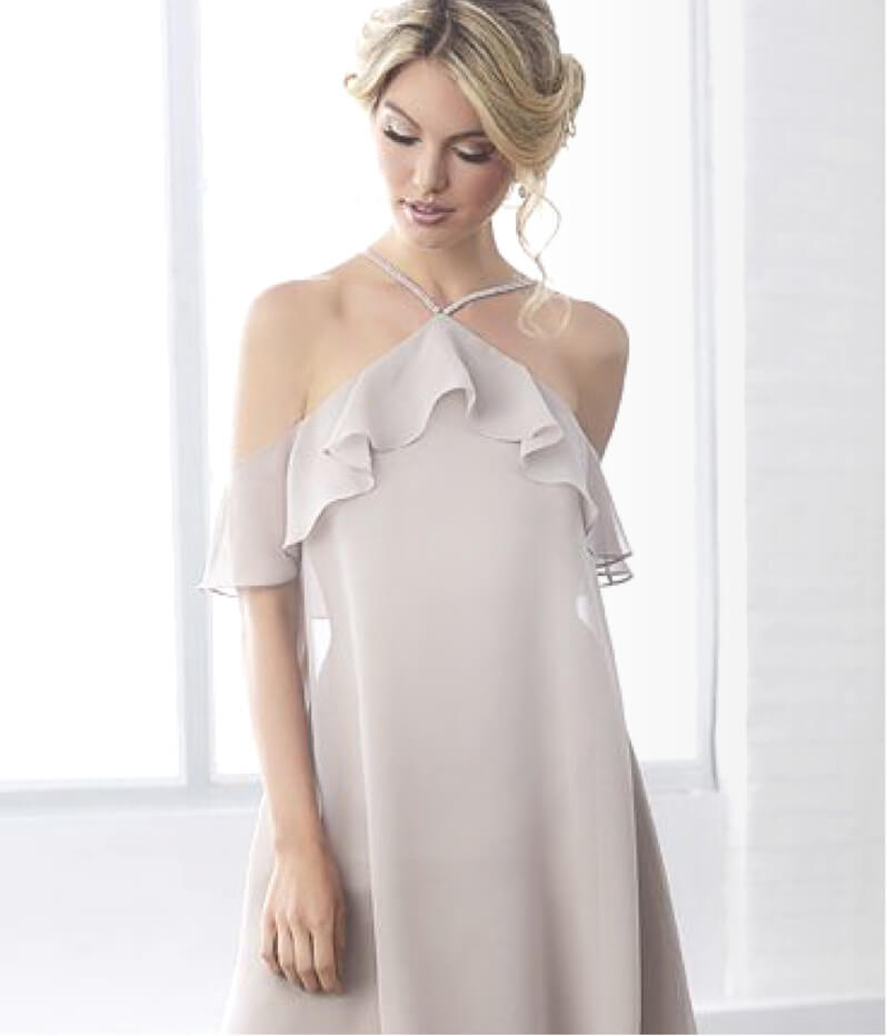 Bridesmaid wearing a light beige dress